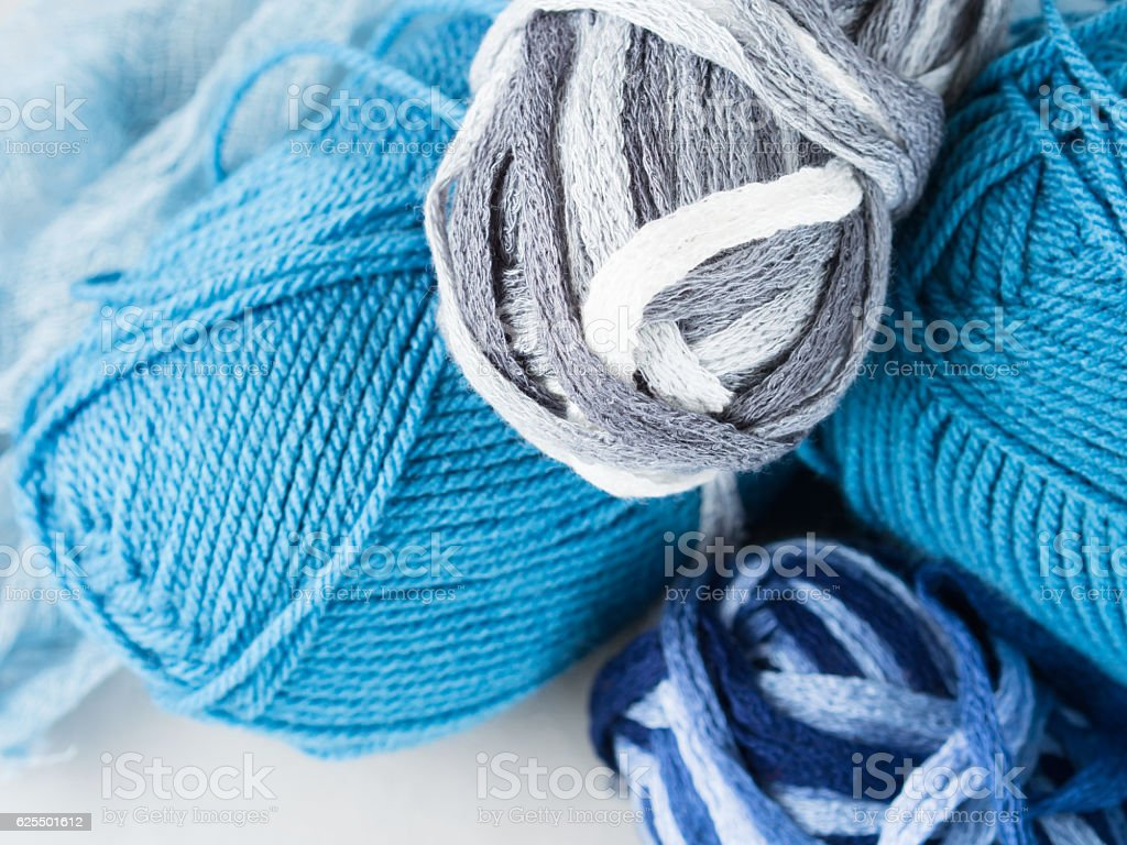 Winter cold color yarn clews with knitting needles stock photo
