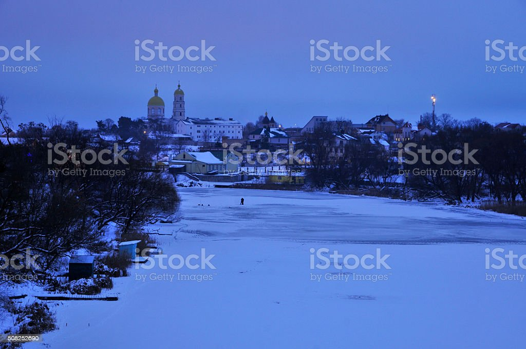 Winter dawn. Panorama of the river Ros and the church. stock photo