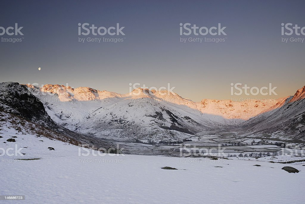 Winter dawn sunlight on Bowfell and Crinkle Crags, Lake District stock photo