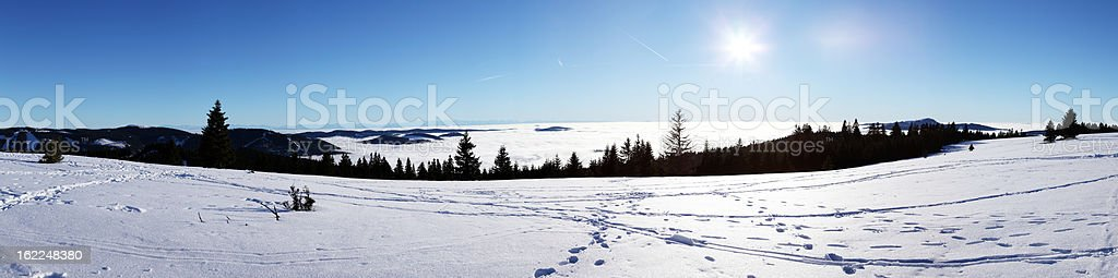 winter day in Black Forest  Stuebenwasen and view with Alps stock photo