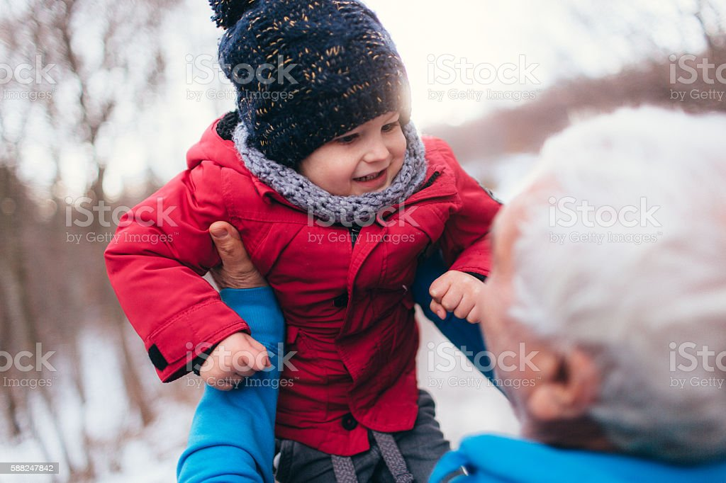 Winter days with grandpa stock photo