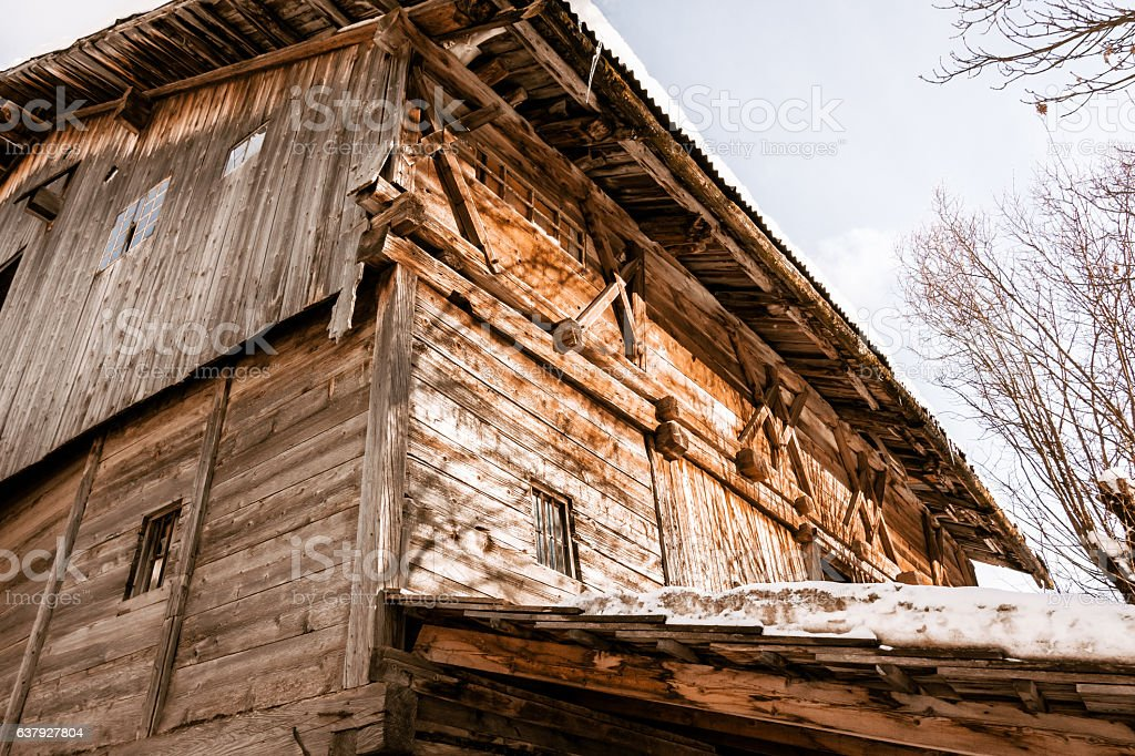 winter dolomites cabin forest stock photo