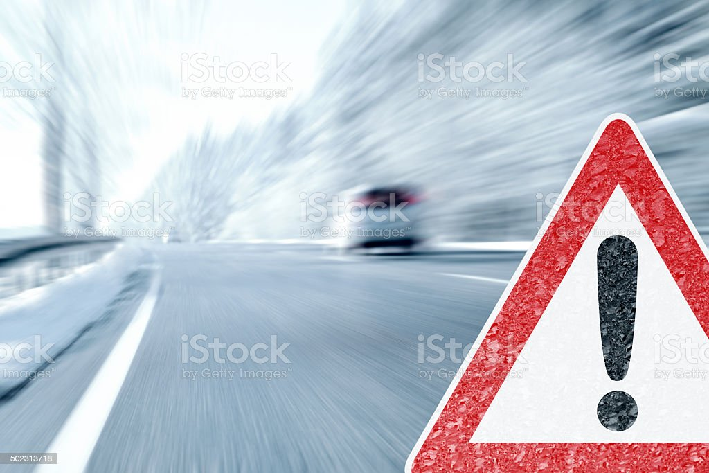 Winter Driving - Caution Ice and Snow stock photo