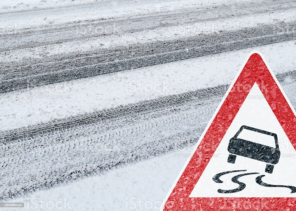 Winter Driving - Caution - Risk of Snow and Ice stock photo