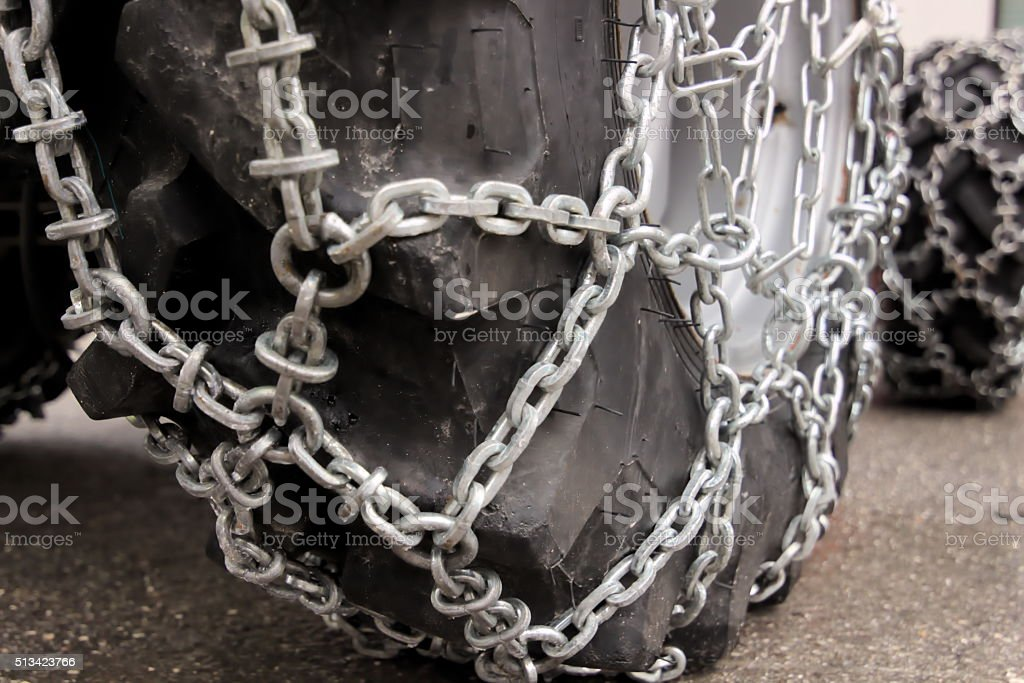 Winter driving eqipment - wheels chain stock photo