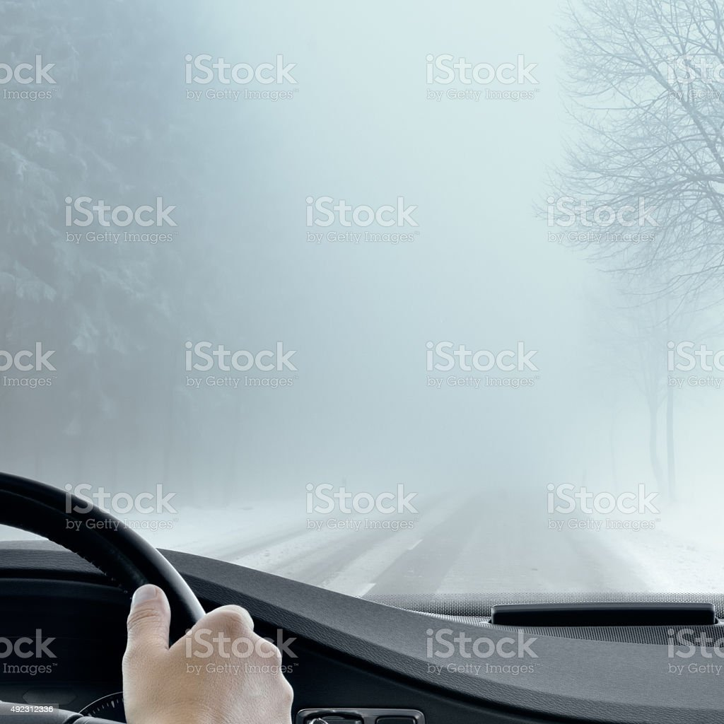 Winter Driving - Foggy Road stock photo