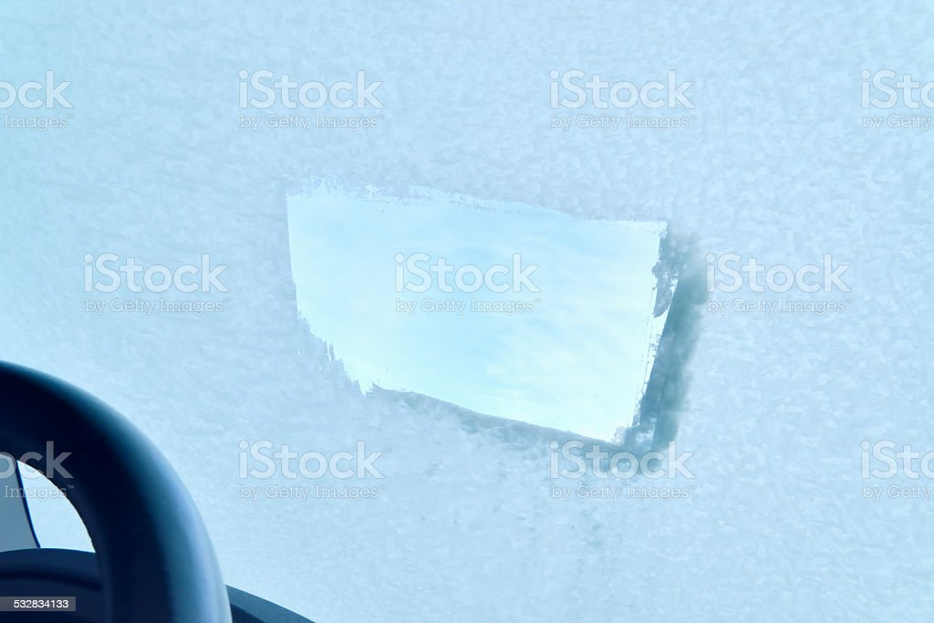 Winter Driving - Icy Windshield - Partially de-iced stock photo