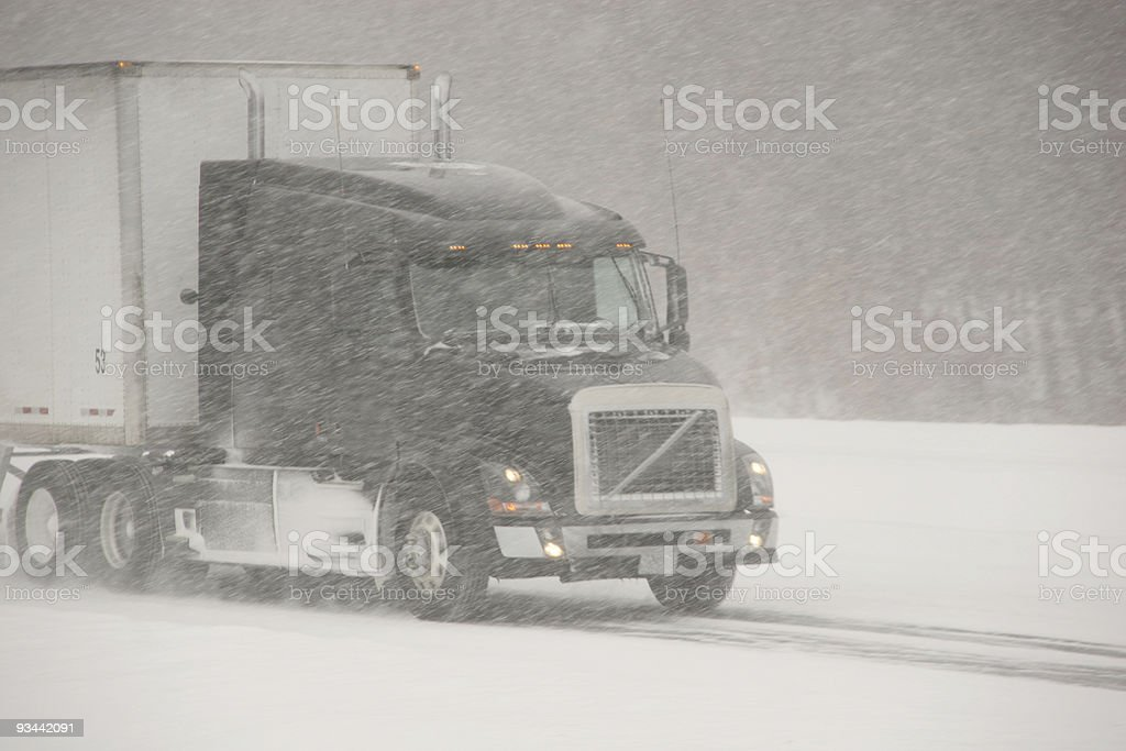 Winter driving in a large truck on highway stock photo