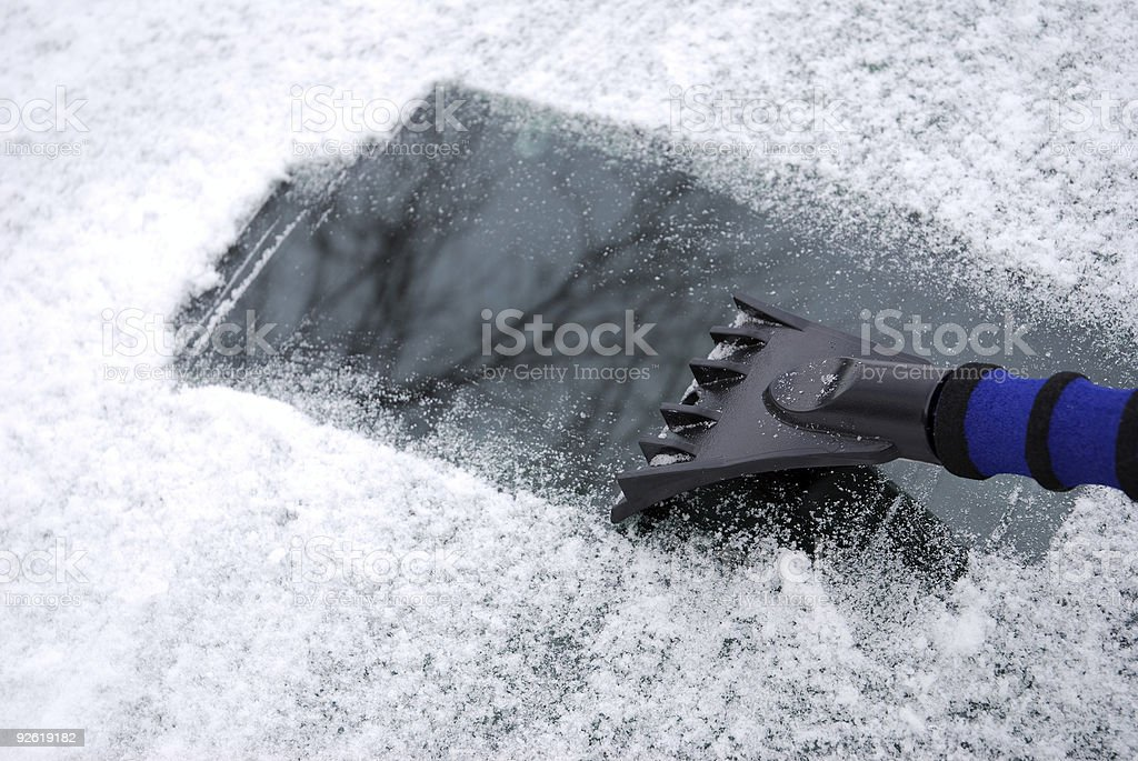Winter driving - snow and ice removal stock photo