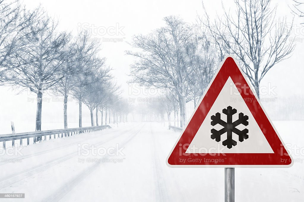winter driving - snowy country road stock photo