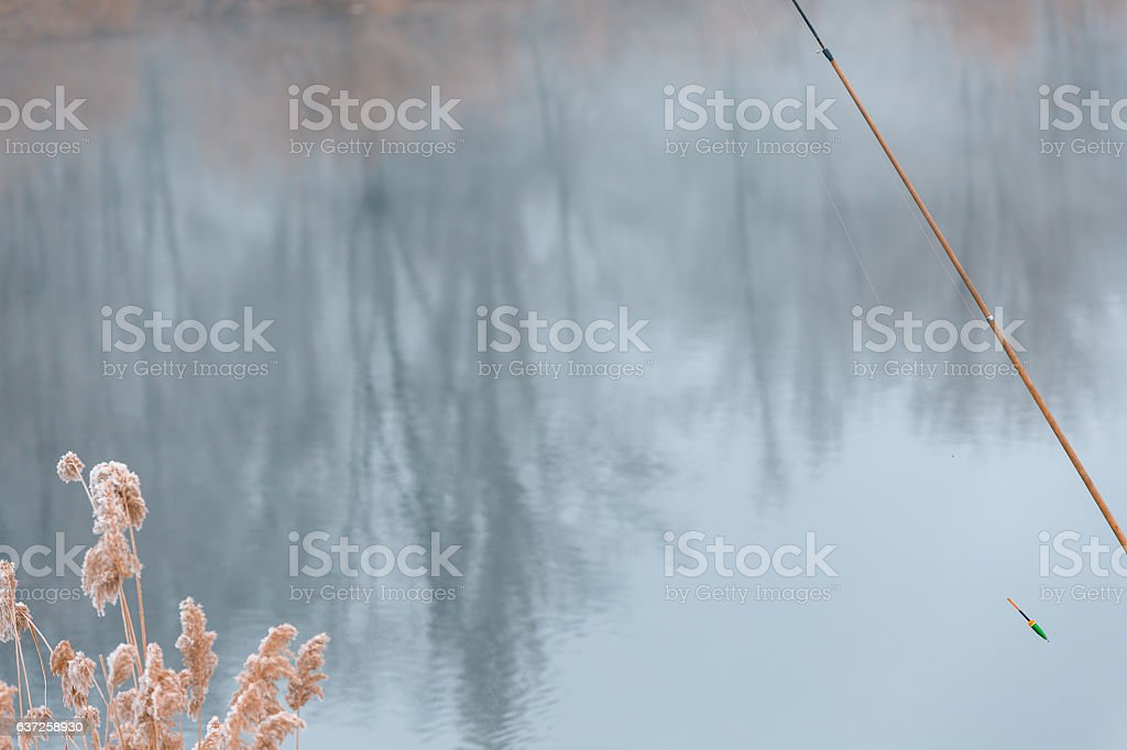 Winter early morning fishing stock photo