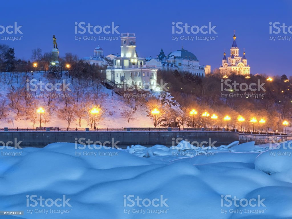 Winter evening in Khabarovsk. The view from the Amur river. stock photo