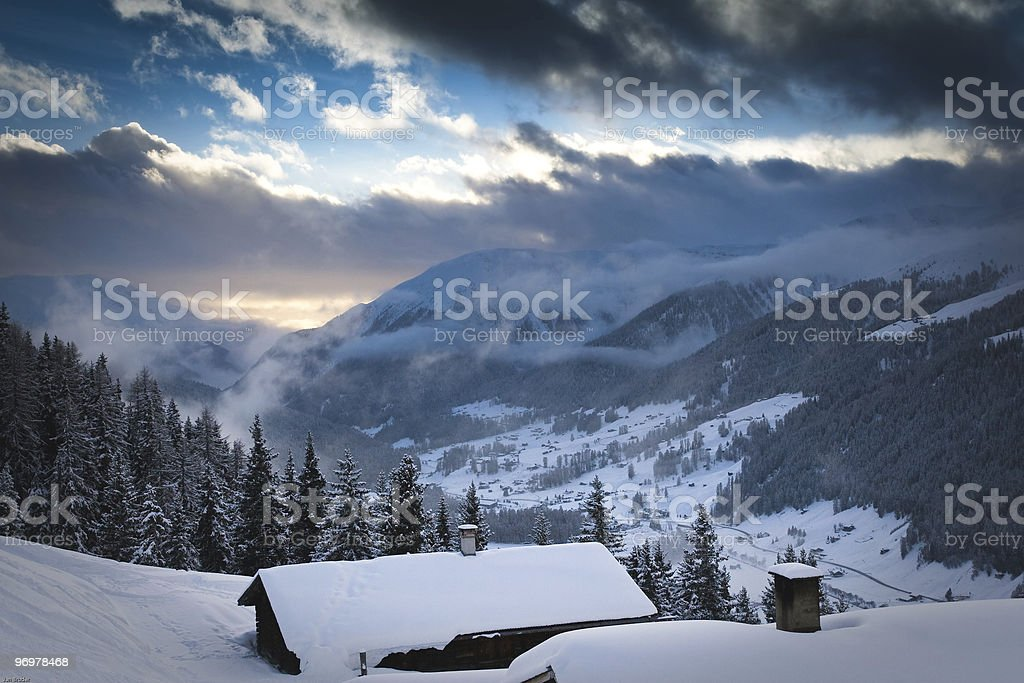 Winter evening overlooking the valley in European alps royalty-free stock photo