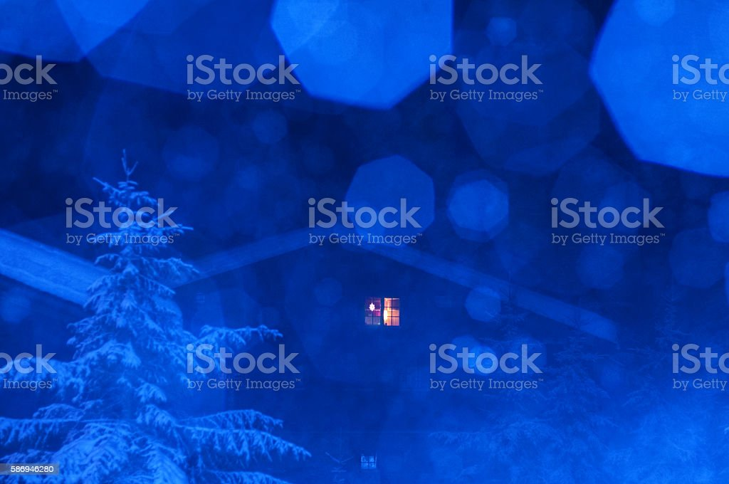 Winter Fairy Tale Scene; Christmas Night While Snowing stock photo