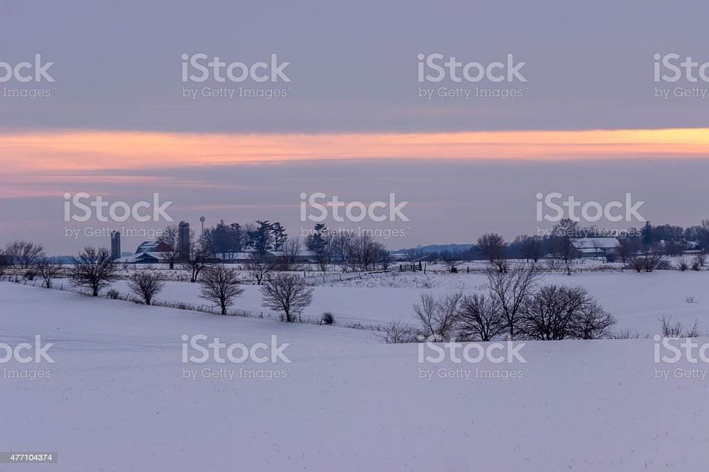 Winter Farm And Fields At Sunset stock photo