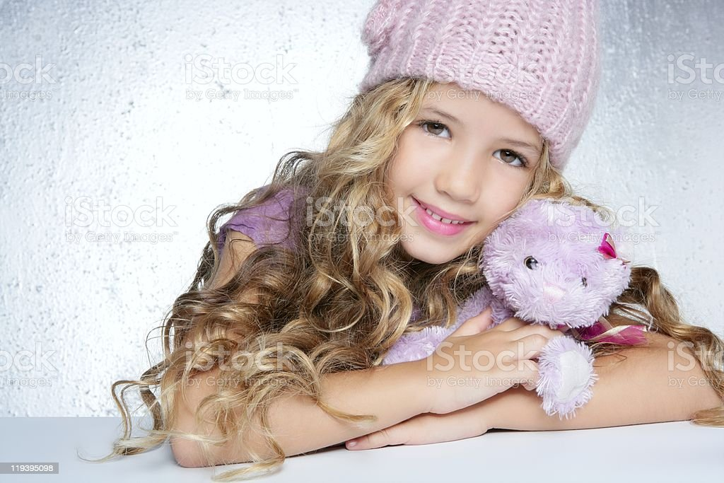 winter fashion cap little girl hug teddy bear smiling royalty-free stock photo