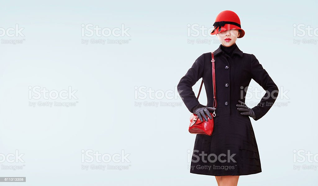 Winter fashion look. red hat,purse, and black coat isolated. stock photo