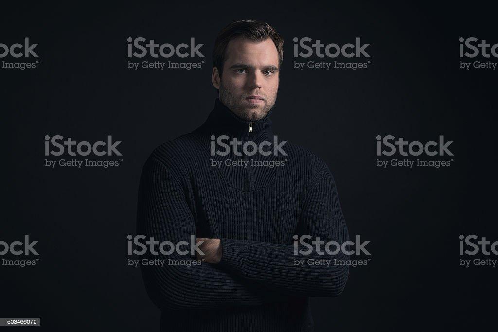 Winter fashion man wearing dark blue turtleneck. stock photo
