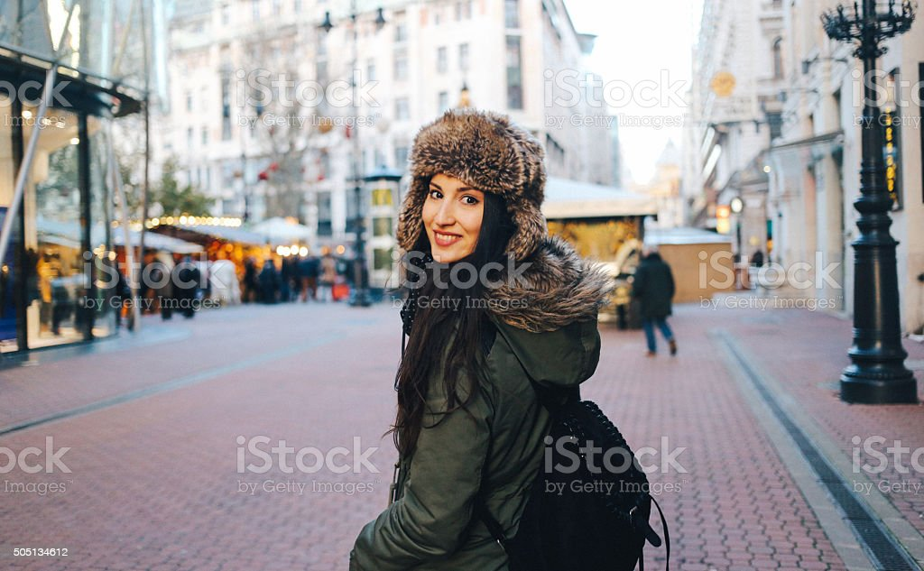 Winter fashion portrait of a young woman in the city stock photo