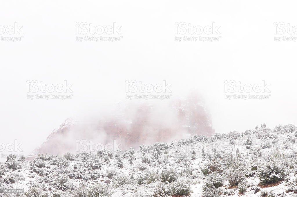 Winter Fog Snow Storm Butte Landscape stock photo