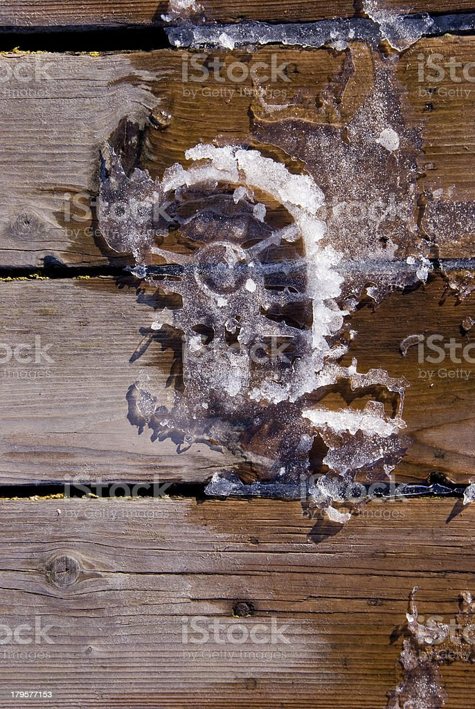 winter footprint on wooden brigde planks stock photo