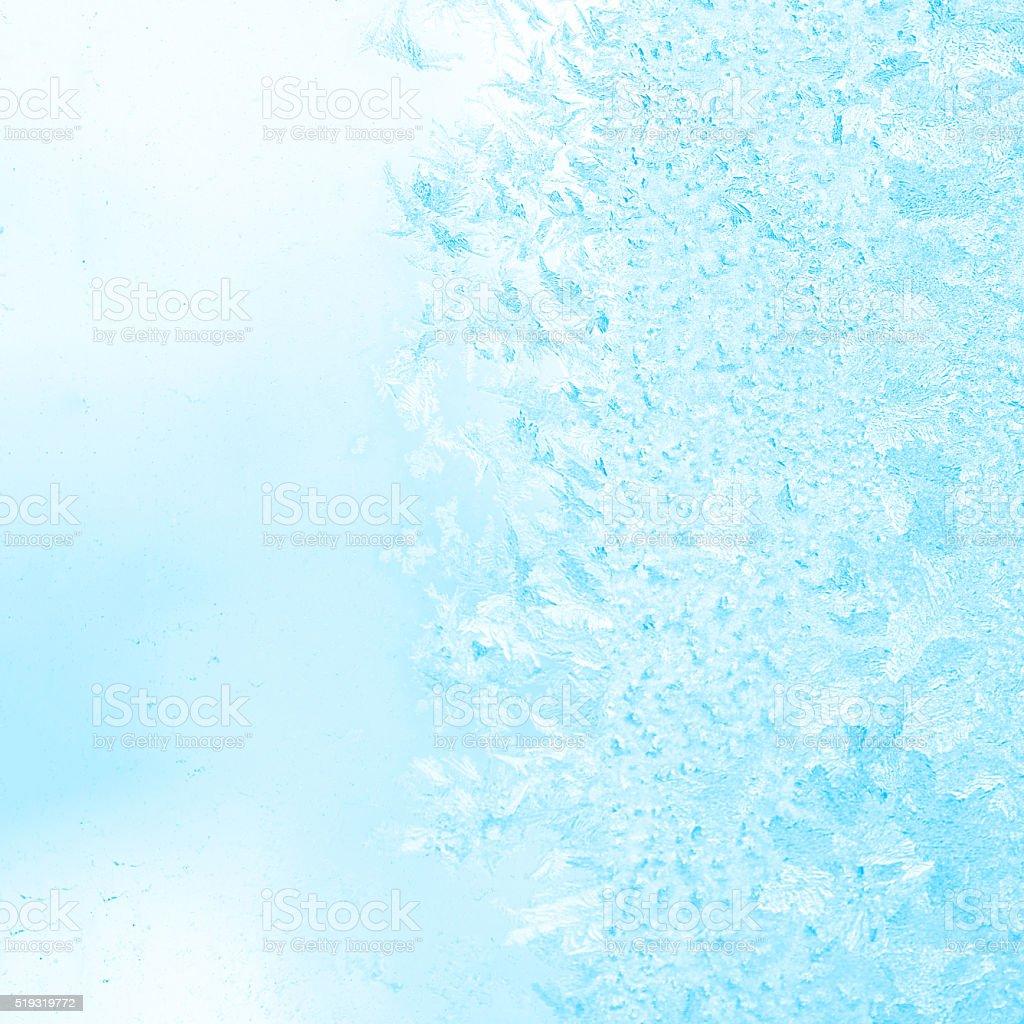 winter frost blue patterns on window, festive background, close stock photo