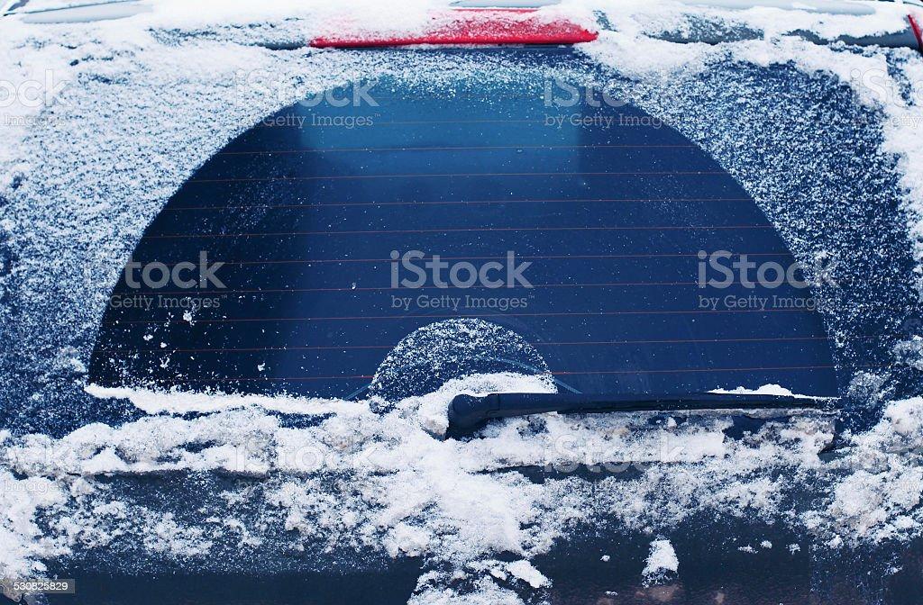 Winter frozen back car window, texture freezing ice glass backgr stock photo