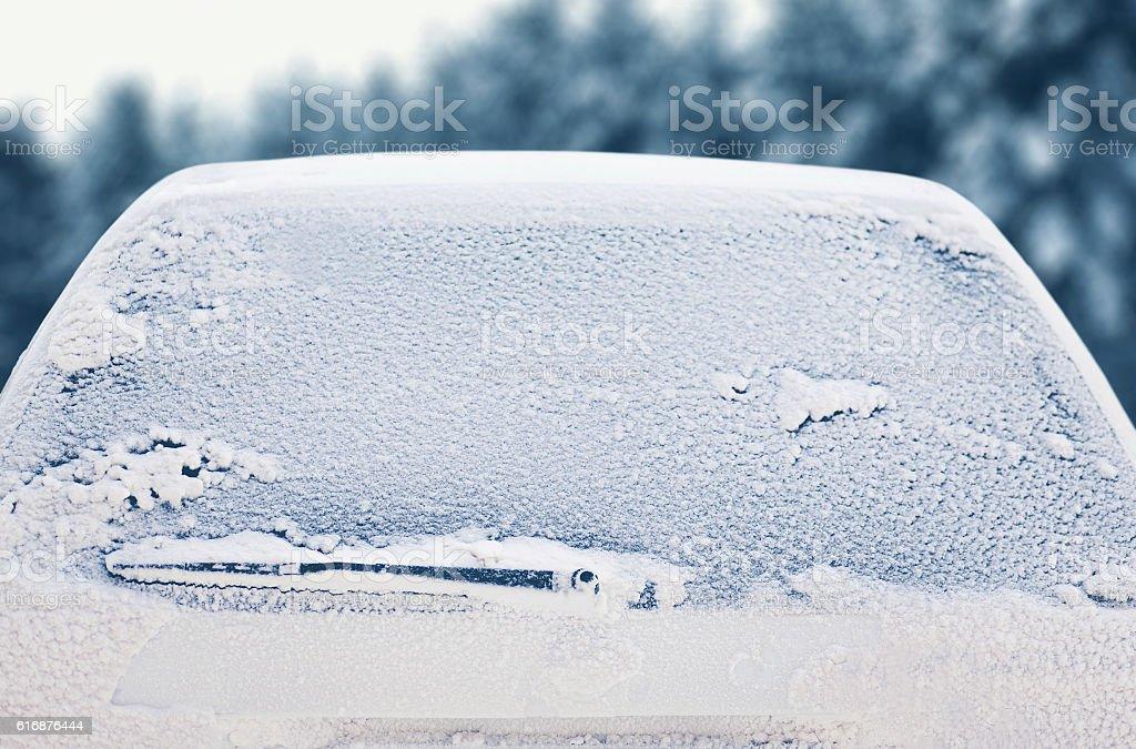 Winter frozen back car window, texture freezing ice glass background stock photo