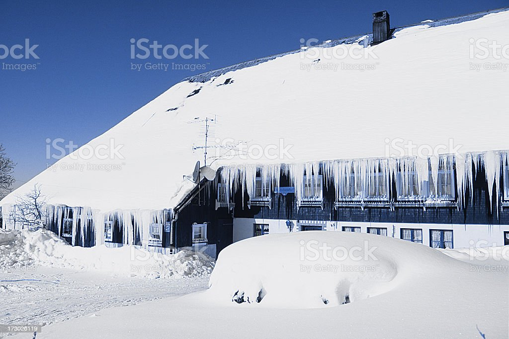 Winter frozen farmhouse in black forest germany royalty-free stock photo