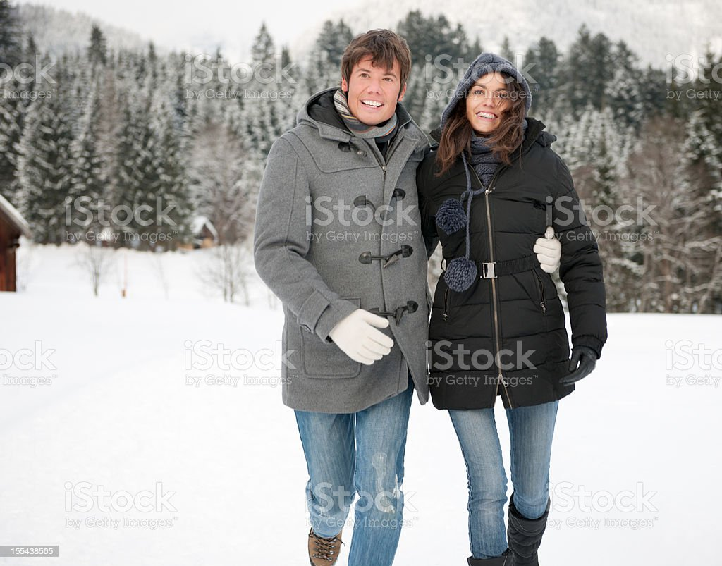 Winter Fun - Candid Couple running through the Snow stock photo