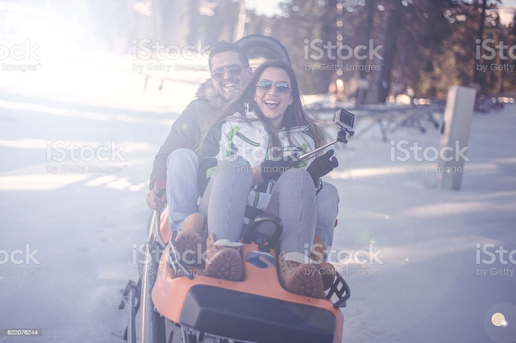 Winter fun on bobsled stock photo