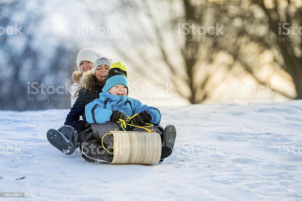 Winter Fun on Tobbogan Hill stock photo