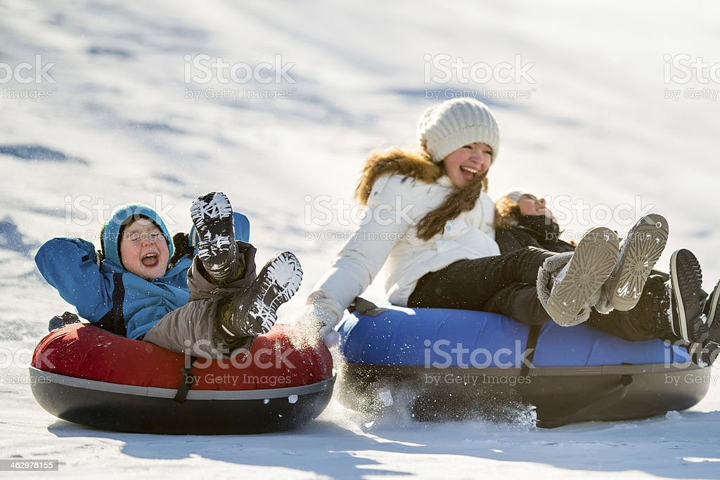 Winter Fun on Tobbogan Hill stock photo