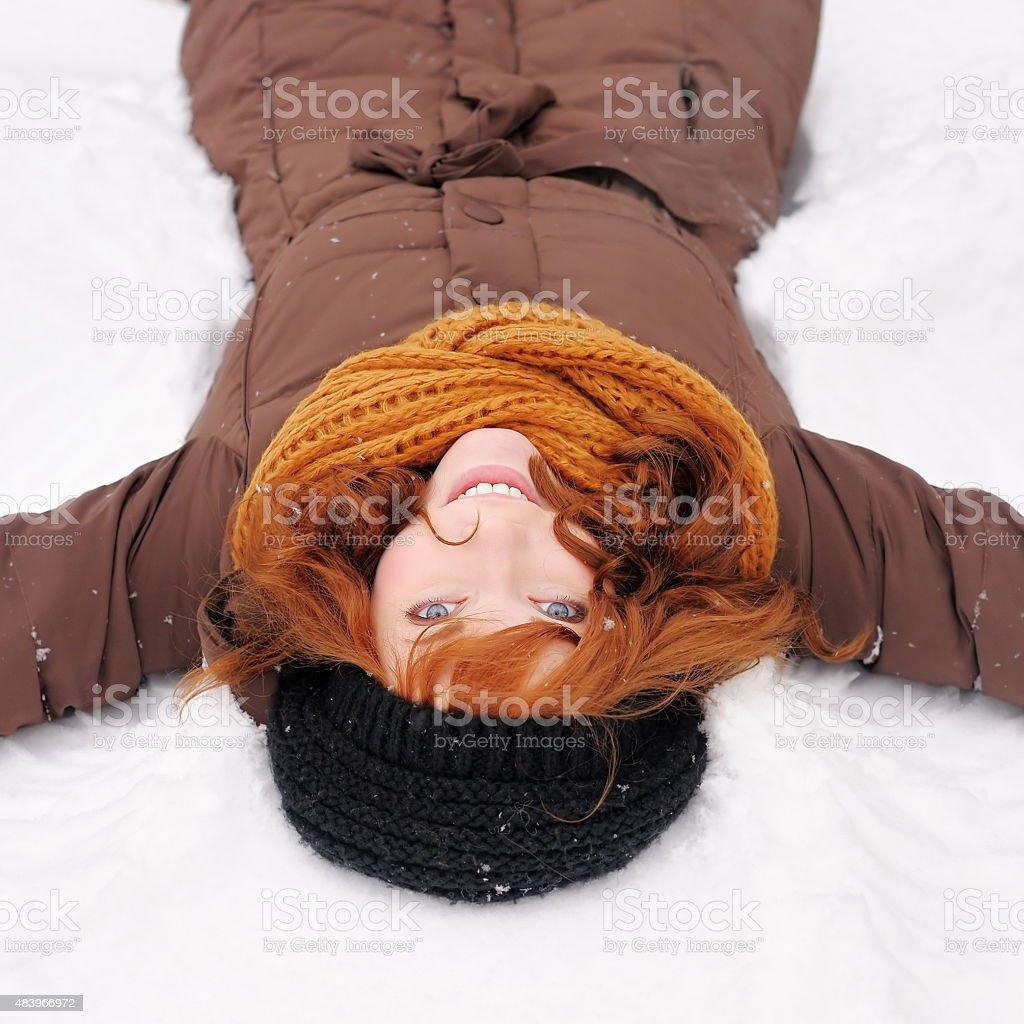 Winter fun - snow angel stock photo