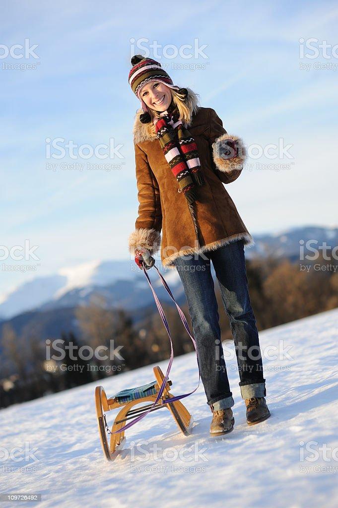 Winter Fun - Woman pulling a Sled (XXXL) royalty-free stock photo