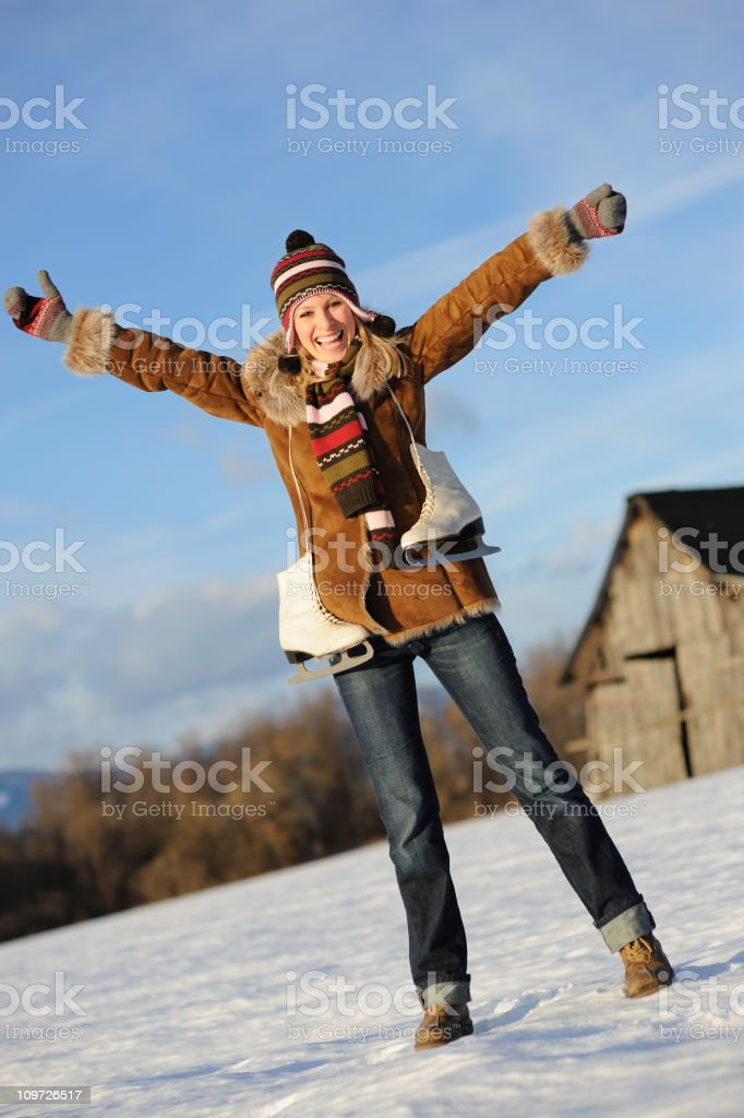 Winter Fun - Woman with Ice Skates (XXXL) royalty-free stock photo