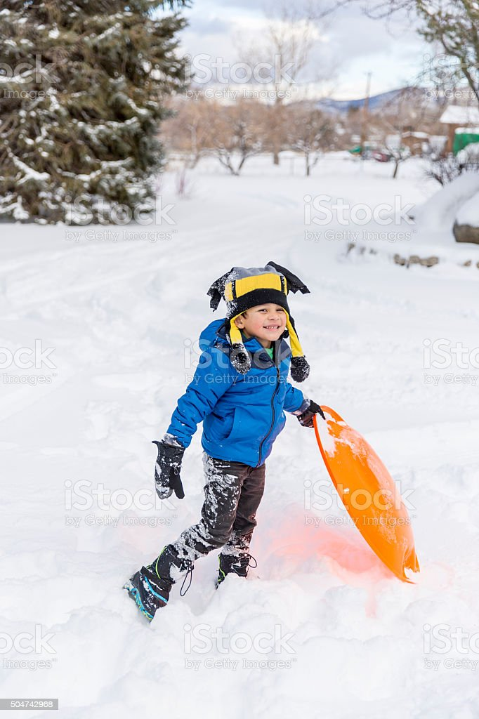 Winter Fun: Young Boy out in the Snow for Fun stock photo