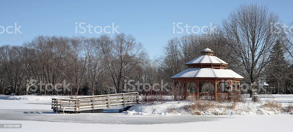Winter gazebo and pond stock photo