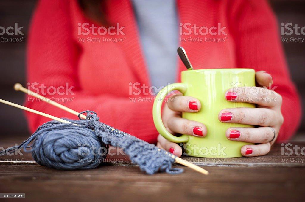 Winter girl knitting stock photo