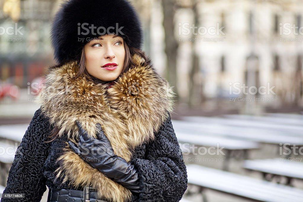 Winter girl posing in park stock photo