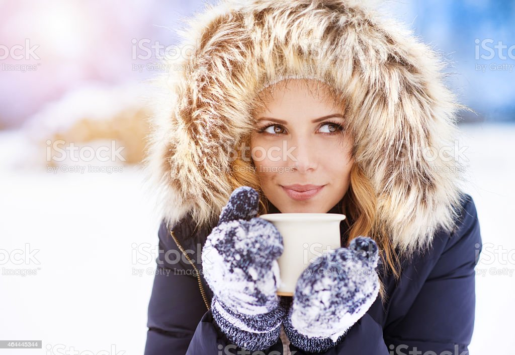 Winter girl with coffee stock photo