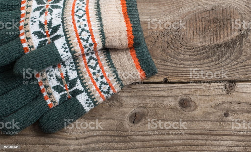 winter gloves on wooden background stock photo