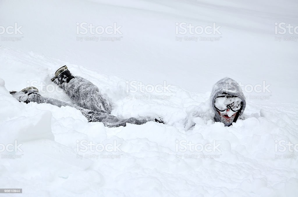 Winter: Guy Looking Up From Belly Flop in Snow royalty-free stock photo