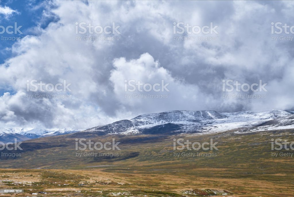 Winter has come to the Siberian steppe, snow-capped mountain peaks. The Ukok Plateau Of Altai. Fabulous cold landscapes. Anyone around stock photo