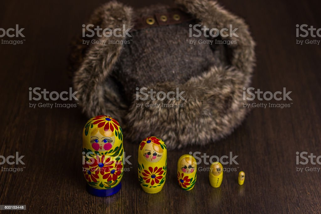 Winter hat ear flaps with raised ears and matryoshka stock photo