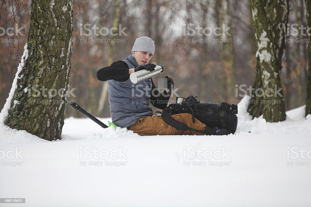 winter hiker having break for cup of tea stock photo