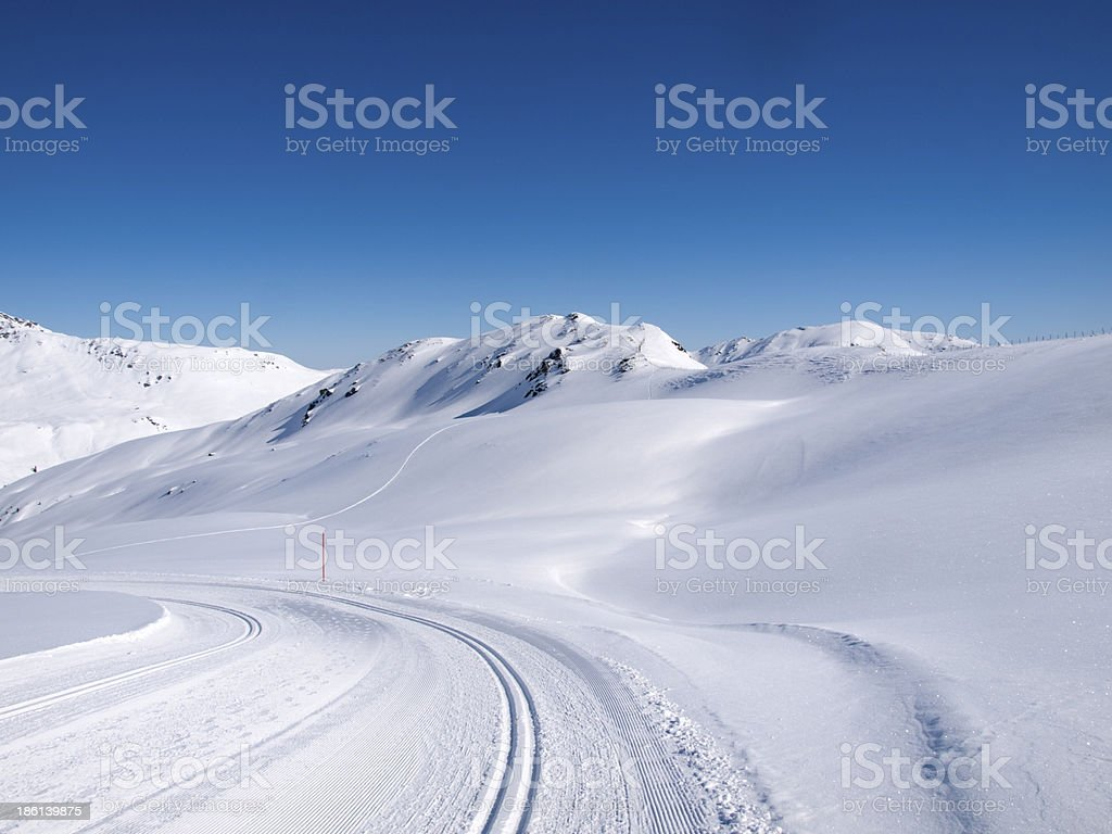 Winter hiking and langlauf trail in the alps royalty-free stock photo