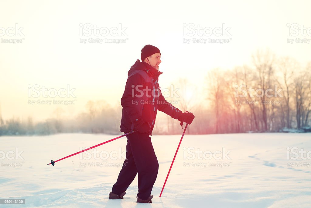 Man Walking with Snowshoes in Winter