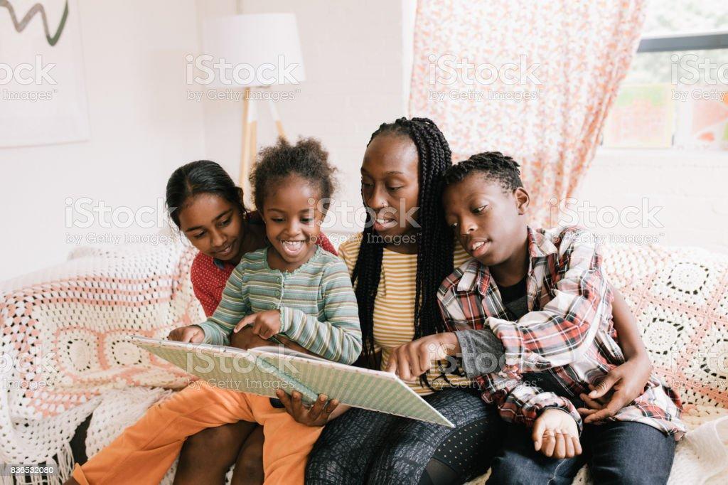 Winter holidays and family reading stock photo