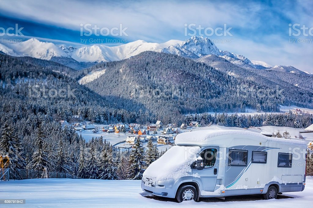 Winter holidays with motorhome in the Mountains stock photo